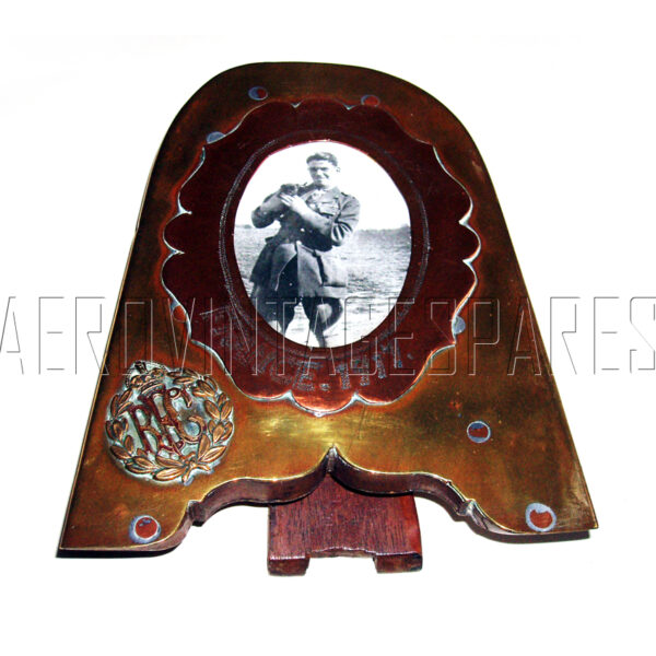 """Brass tipped wooden 1st WW prop blade picture frame with cooper frame, engraved """"France 1917"""" around a real photo of 1st WW pilot. There is a genuine RFC badge soldered o it. 8"""" high x 6"""" wide and quite heavy."""