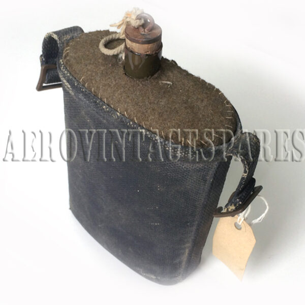 Vintage metal RAF water canteen covered in green felt with a treated canvas covering, including attachment facility to strap, string with cork and metal stopper. An absolute must for the collector who wants a complete ensemble for the vintage RAF pilot.